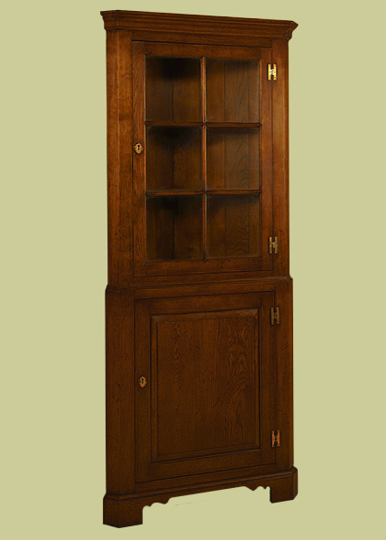 Corner cupboard, with astragal glazed upper section, for display, and lower section serving as corner cupboard storage.