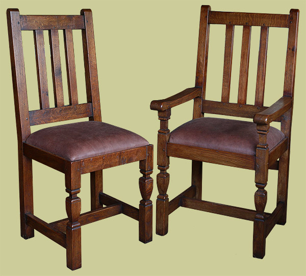 Arts and Crafts style oak dining chairs with leather upholstered drop in seat cushions.