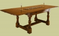 Oak extending table with leaves out.