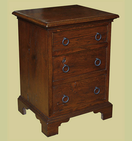 Oak bedside drawers in period style.