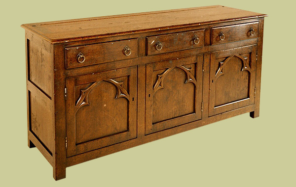 Dresser base, with unusual gothic style doors, having hand carved trefoil shaped design.