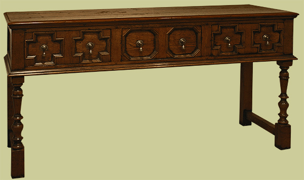 Handmade 17th century (Jacobean) style, solid oak open dresser base, with applied geometric mouldings to the drawers and standing on hand turned legs.