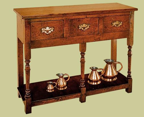 A small and plain, but very pretty, oak 3-drawer potboard dresser base.