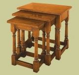 Three oak joined stools as front loading nest of tables