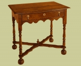 Period style oak side table with cross stretcher & bun feet