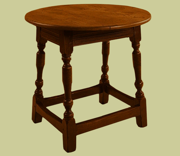 Antique style oak lamp table with circular top.