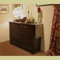 Small 2 drawer oak dresser base in showroom.