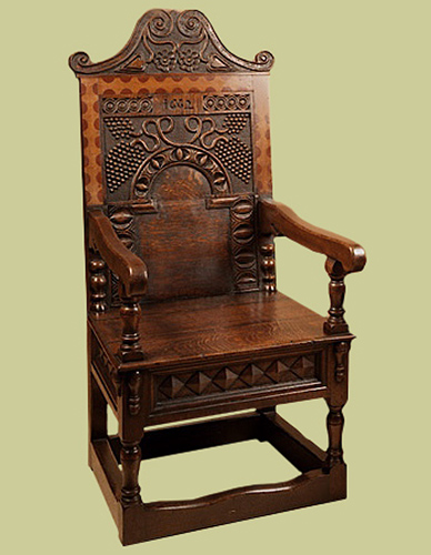 Charles 2nd Style oak armchair, with hand carved back panel, cresting rail and seat rails.
