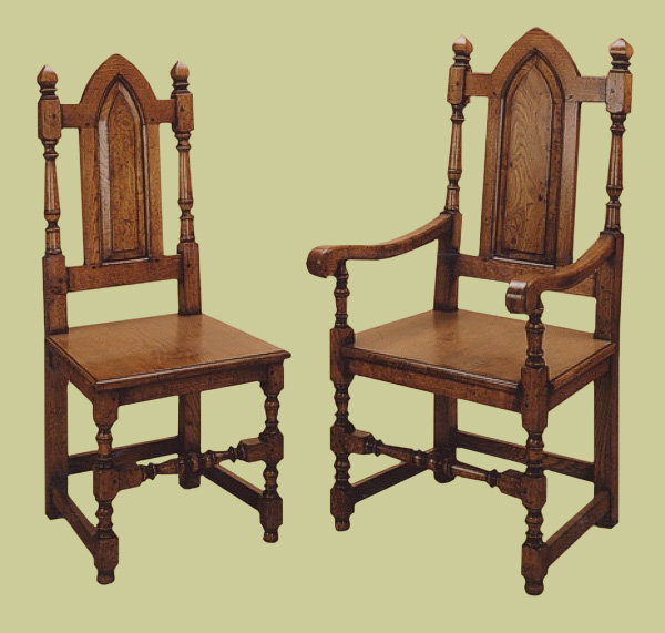 Joined Gothic style oak solid seat side chairs and armchairs.