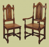 Joined gothic style oak dining chairs