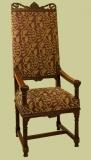 Ornately carved throne type oak upholstered armchair