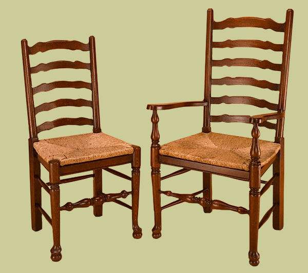 Ladderback country style dining chairs (originally made in large numbers during the 18th and 19th century), with rush seats.