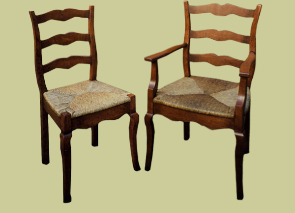 Provence style cabriole leg ladderback side chairs and armchairs, with drop in rush seats.
