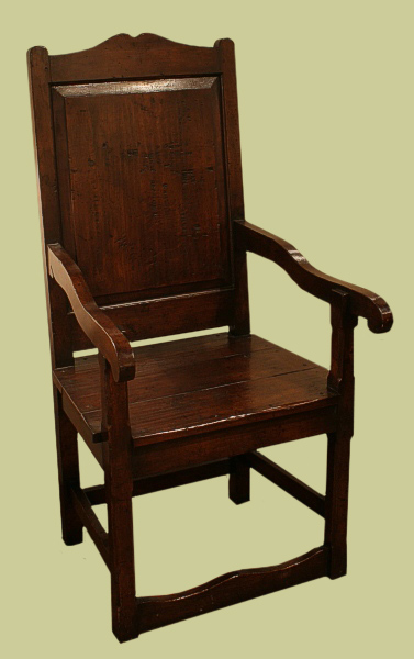 Panelled back and solid seat period style armchair.