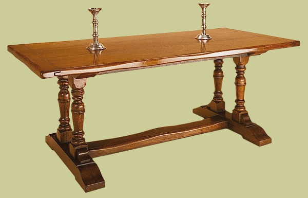 Twin pedestal dining table, hand crafted from solid English oak with paired rising baluster supports.