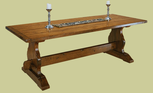 Trestle table handmade from solid oak with shaped slab ends and planked top.