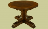 Small oak round dining table with Gothic style brackets