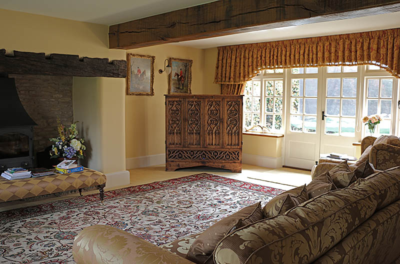 Hand carved oak TV cabinet in Warwickshire country house sitting room