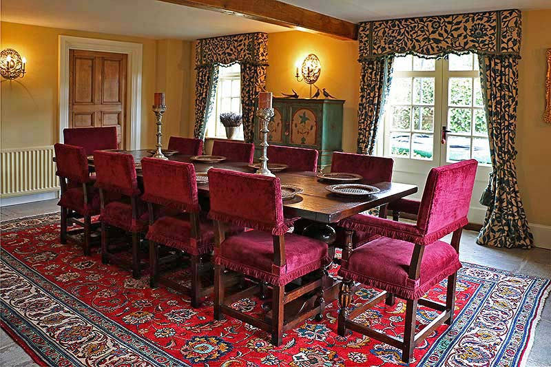 Antique style oak pedestal table and velour upholstered dining chairs, in Warwickshire country house
