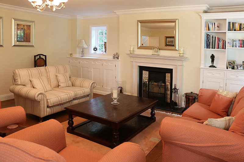 Bespoke traditional style large oak coffee table, in sitting room of Berkshire country home