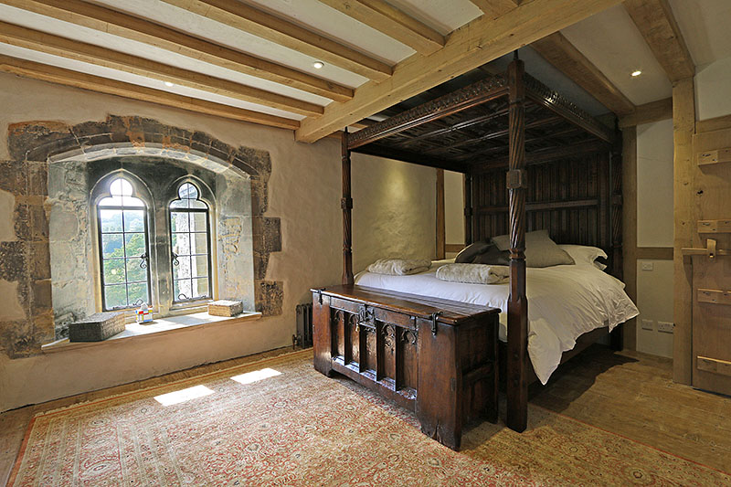 14th century style oak chest and 16th century style hand carved bespoke oak four poster bed, in clients country manor house