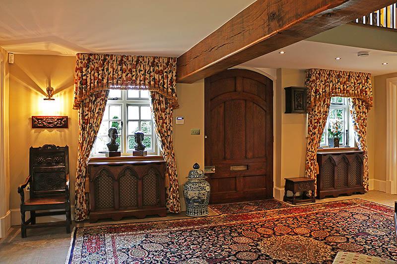 Lutyens inspired bespoke handmade Gothic style oak radiator covers, in hallway of Warwickshire country house
