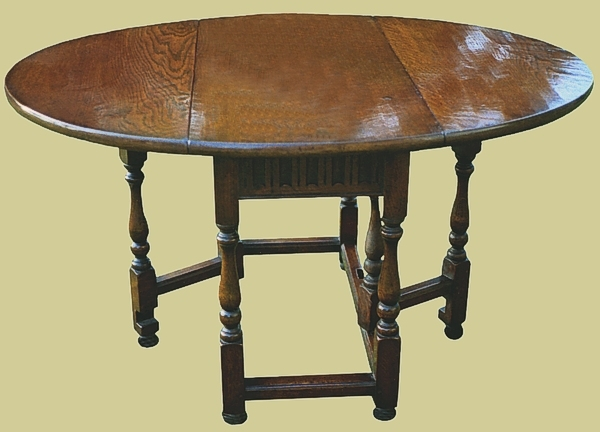Gateleg dining table carved