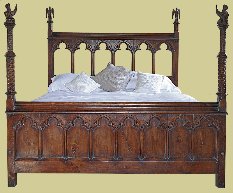 Late Gothic style oak carved bed with griffins and angels