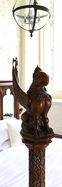 Gothic style carved oak griffin on bed pootpost