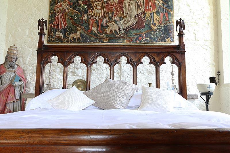 Open tracery oak bed headboard