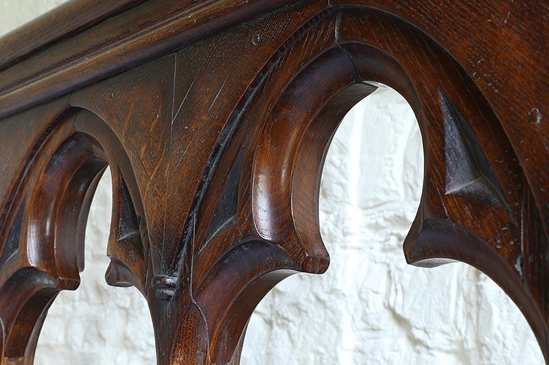 Trefoil head detail of open tracery headboard on Gothic style oak bed