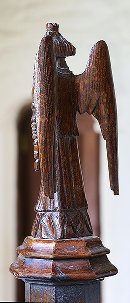 15th century style carved oak angel back view