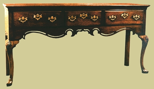Open dresser base with fretted rail