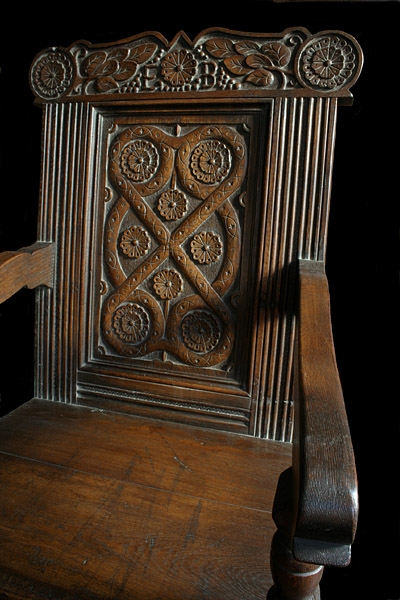 Carved oak 17th century style armchair detail