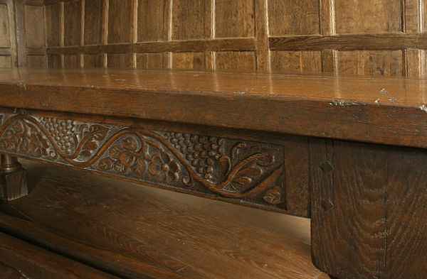 Grape and flower carving on oak refectory table