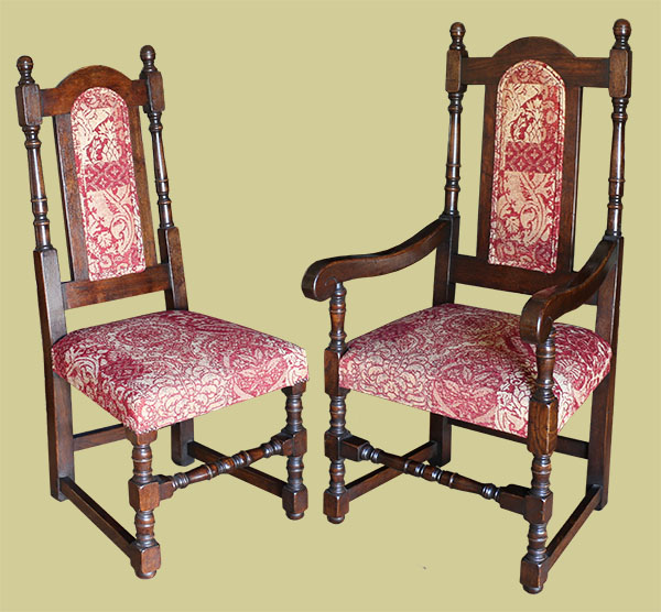Oak chairs, in period style, with upholstered back panels and stuff-over seats.