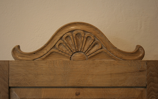 Carved cresting rail detail on oak chair