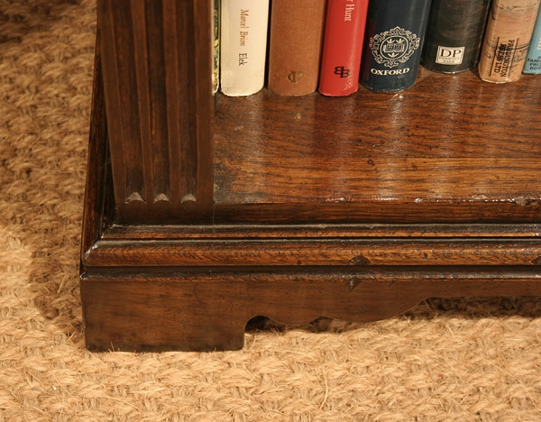 Reproduction oak bookshelves plinth detail