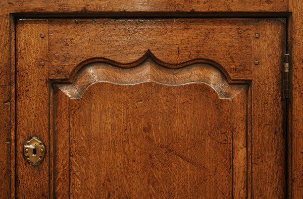Ogee panelled oak TV cabinet door detail