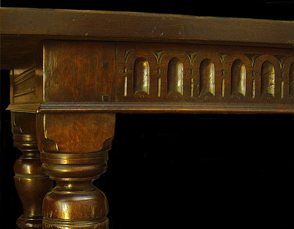 Thumbnail carving on oak refectory table