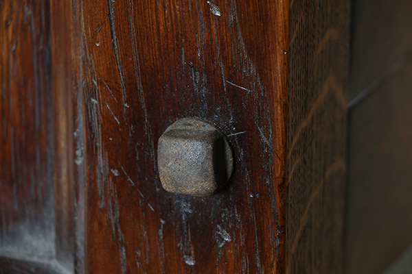 Gothic style oak bed, detail of iron fixing bolts.