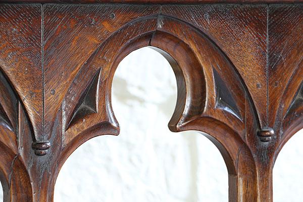 Open oak tracery detail on gothic style bed headboard