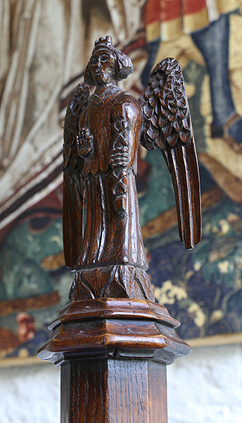 Carved oak angel, 15th century style, on gothic inspired Bed.