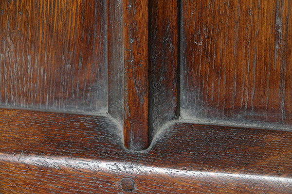 Gothic oak bed footboard detail, showing hollow chamfers.