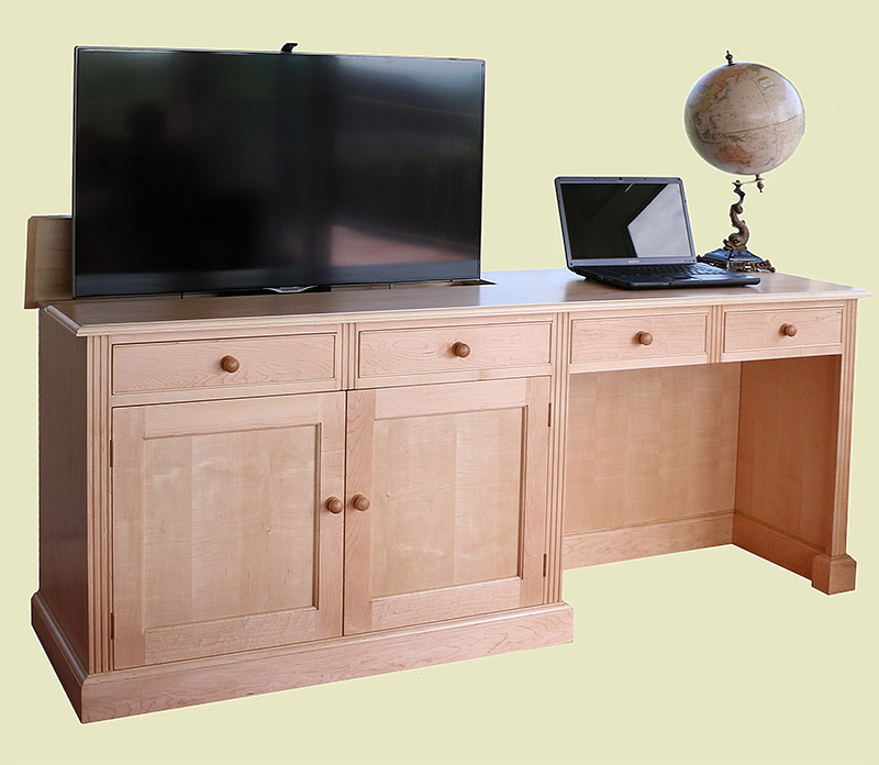 Maple desk and TV cabinet with TV lift extended showing flat screen television