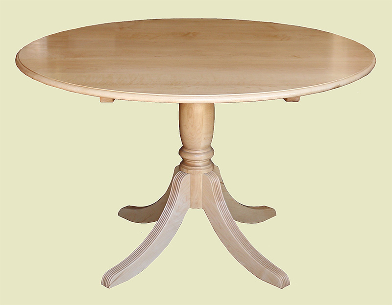 Round maple dining table on pedestal base