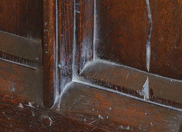 Early period style moulding detail on oak chest