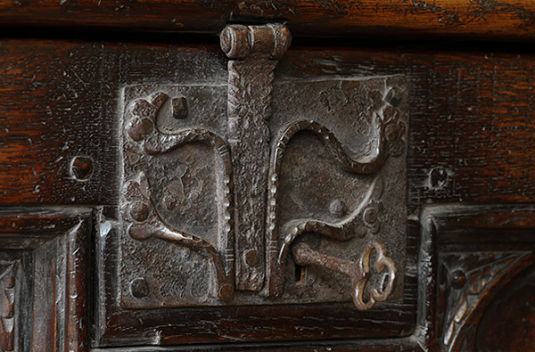 Oak clamped front chest Medieval style lock detail.