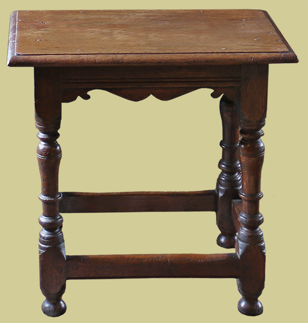 17th century style oak joined stool with baluster legs and shaped rails.