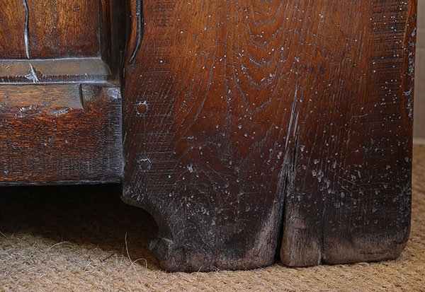 Ageing detail on feet of medieval style oak chest
